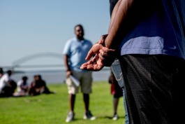 Greg Woodberry, a member of the Official Black Lives Matter Memphis, clasps his hands behind his back while performing an adapted rap during the Bridge Shut Down reunion at Tom Lee Park.