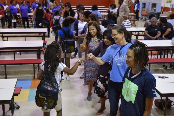 As the students received their backpacks they high-fived and fist-bumped volunteers for the ZIP Code 38126 Back to School Project.