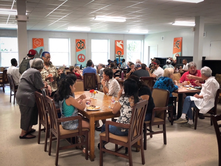 Community members sat down to enjoy hamburgers, hotdogs, and chips in the bright and airy space. (Shelda Edwards)