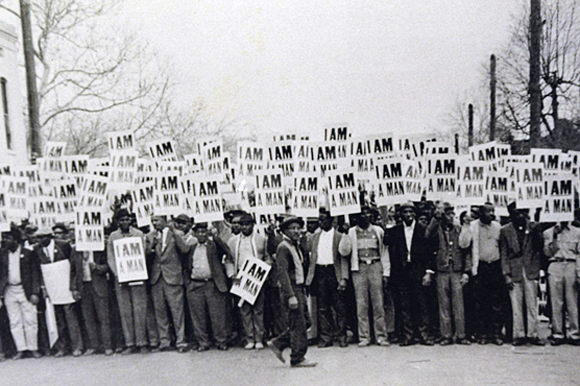 "The 1968 sanitation workers' on strike hold up ""I Am A Man"" signs in protest of their treatment by the city."