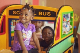 Children play at Pursuit of God Church while their parents attend class next door. The new program teaches about language and brain development for children zero to 30 months. (Agape)