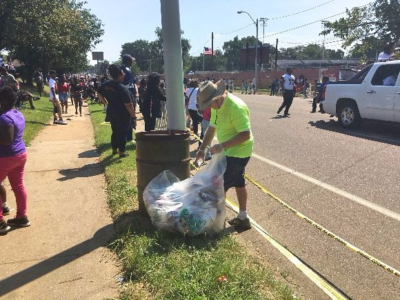 Volunteers pick up trash at the 2017 Orange Mound parade.