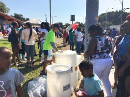 Volunteers facilitate recycling at the 2017 Orange Mound Parade.