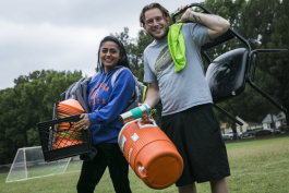 Husband and wife Nancy and Patricio Gonzalez carry equipment to the Gaisman Community Center at the end of game day. They are the directors and coaches of Illegal Arts Memphis soccer league. (Natalie Eddings)