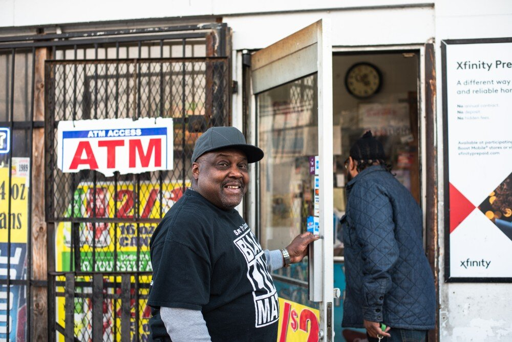 Rufus Sykes cracks a smile as he holds the door open for a customer at the South Memphis Grocery on West Mallory Avenue. Sykes co-owns the corner store with other family members. (Malik Martin)