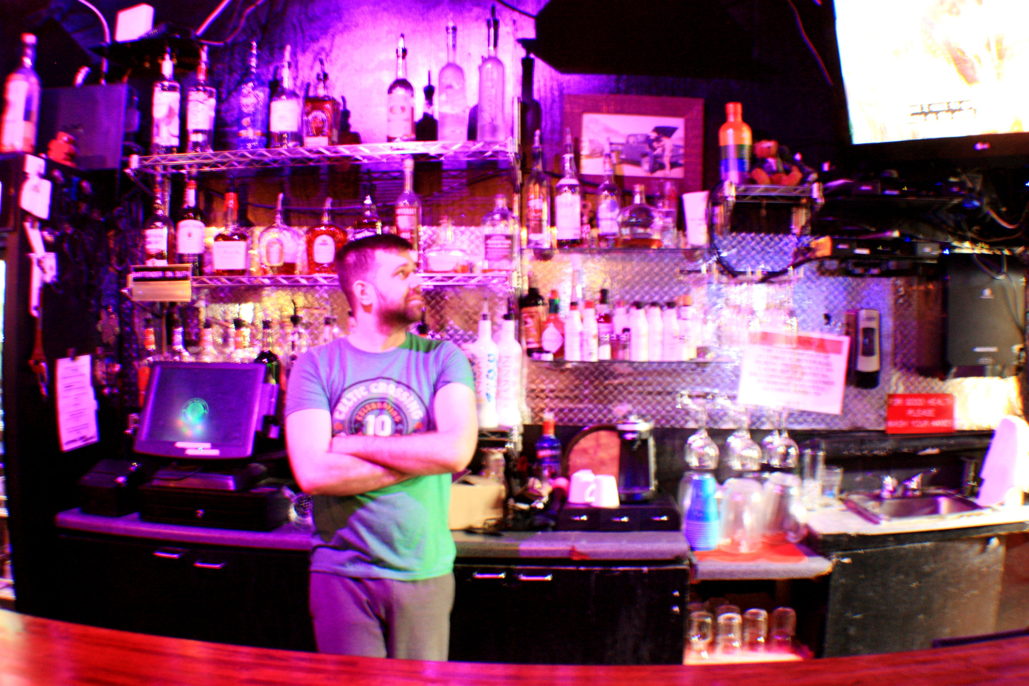 A local bartender stands alone at his station. Many Memphis bars and restaurants are already closing to control the spread of COVID-19. Many more are expected to close with the possibility of a city- or statewide shutdown. (Cole Bradley)