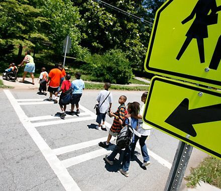 Binghampton Students cross at a crosswalk. Sidewalks and crosswalks are part of the physical infrastructure that can be improved with TIF funding. (Submitted)