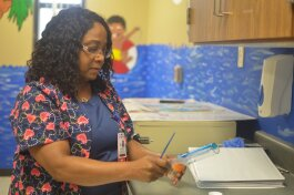 School nurse Patricia McCraw prepares medication for a student at A.B. Hill Elementary. McCraw is part of a school nurse pilot program facilitated by Le Bonheur Children's Hospital, Shelby County Schools and Urban Child Institute. (Cat Evans)