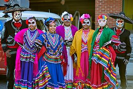 Members of Ballet Folklórico Herencia Hispana gathering before the parade in 2019 Dia de los Muertos parade. (Memphis Brooks Museum of Art)