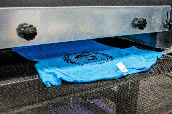 Printed t-shirts process in the dryer.