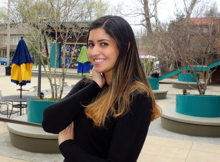 17 Berkshire owner Nuha Abuduhair poses in Overton Square near her new shop. (Aisling Maki)