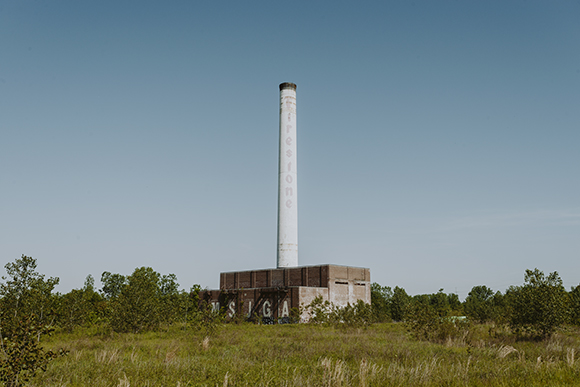 The white smokestack of the former Firestone plant in North Memphis. (Houston Cofield)