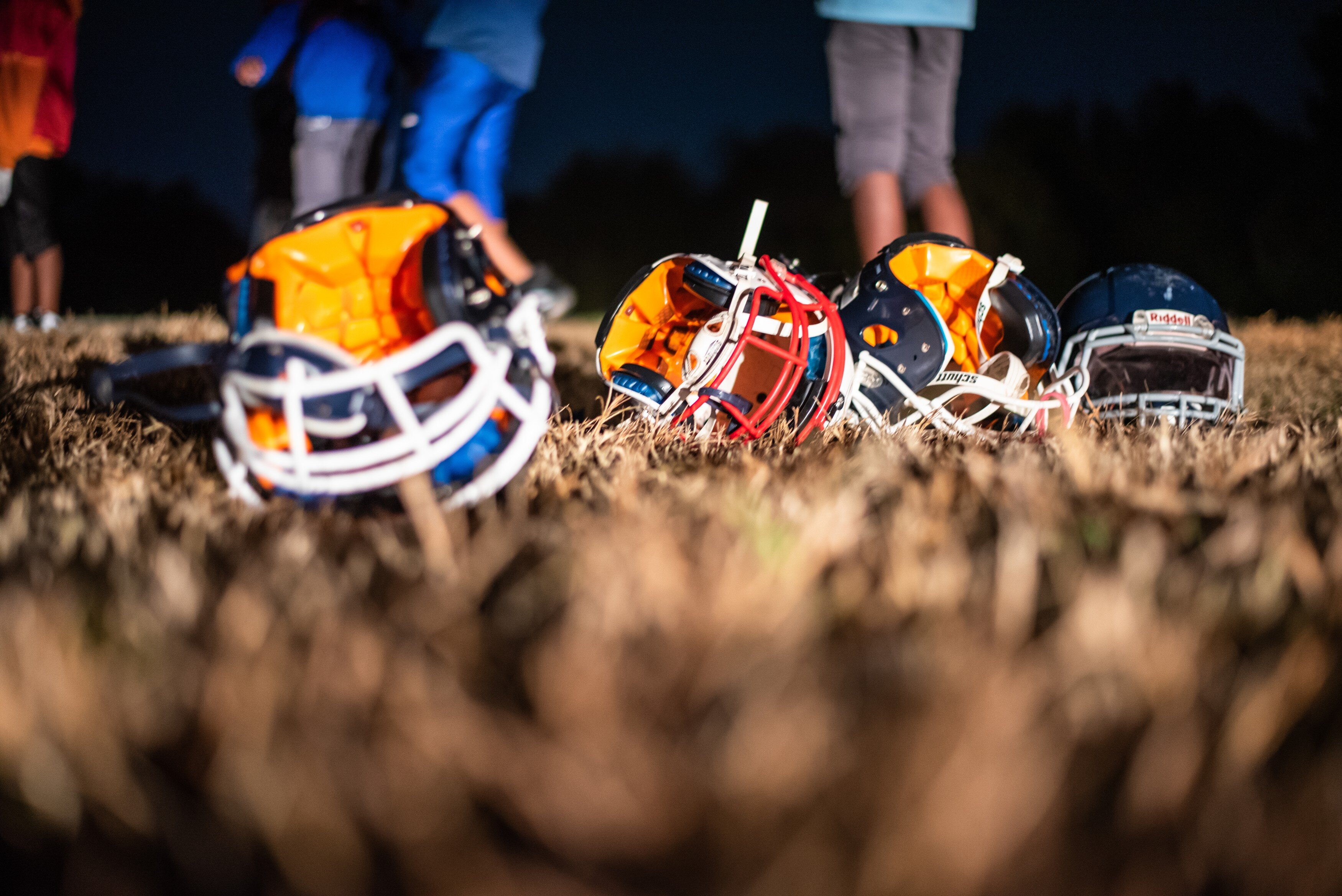 Ridgeway Cougars helmets rest in the grass during practice. (Malik Martin)