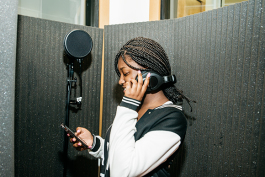 Mickele Bridges collaborates with other students to produce a song in Cloud901's recording studio.