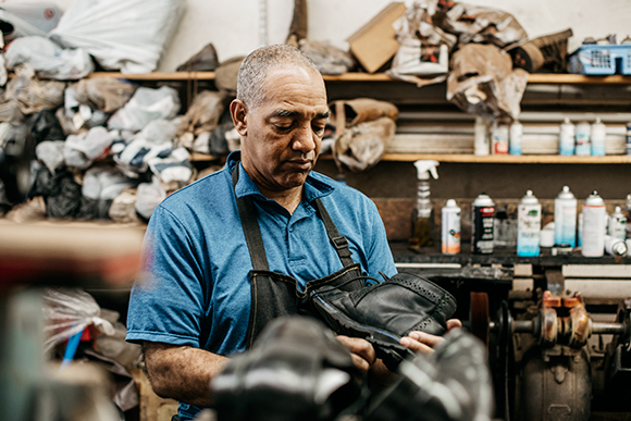 Alvin Hooper, owner of Nu-Life Shoe Repair, started in the shoe business right after graduating high school.