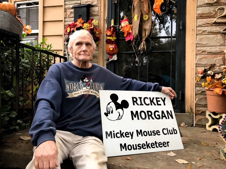 Ric Morgan, 74, poses outside of his Heights home with the sign he uses for public appearances. During the Mickey Mouse Club, Morgan was known as 'Rickey.' (Cole Bradley)