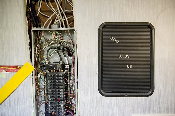 A fuse box and sign inside the future Eggxactly Breakfast and Deli restaurant. (Brandon Dill)