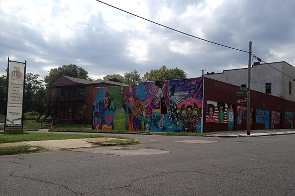 A mural was painted on an abandoned building across from the pocket park on Wellington.