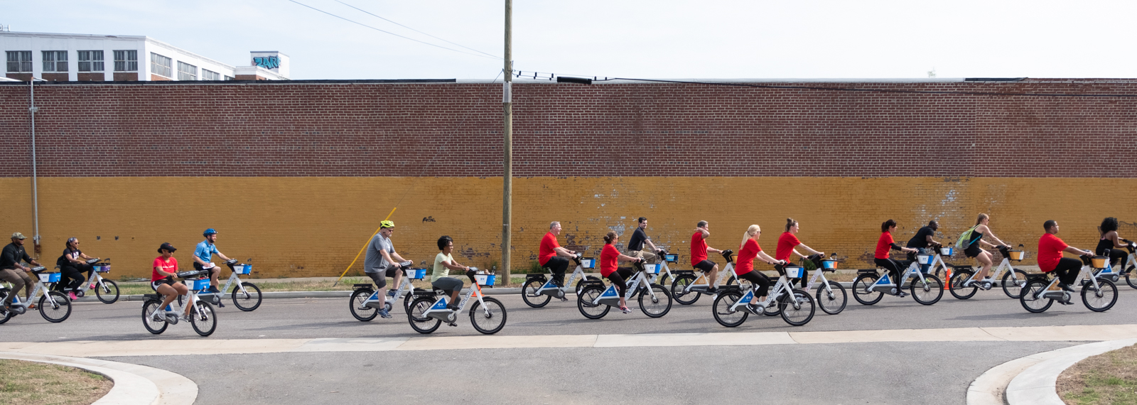 Explore Bike Share cyclists set out along Keel Avenue.  <span class='image-credits'>Brandon Dahlberg</span>