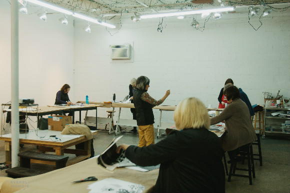 Susan Maakestad directs a collage class at the Flicker Street Art Studio.