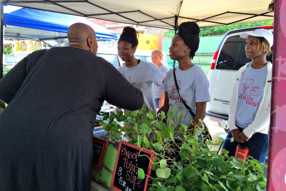 Girls Inc. Frayser Youth Farm girls sell produce at the Memphis Farmers Market