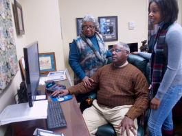 Winston Gipson confers with his wife and daughter, who help run Gipson Mechanical Contractors, a family-owned business in Memphis for 35 years. (Laura Faith Kebede)