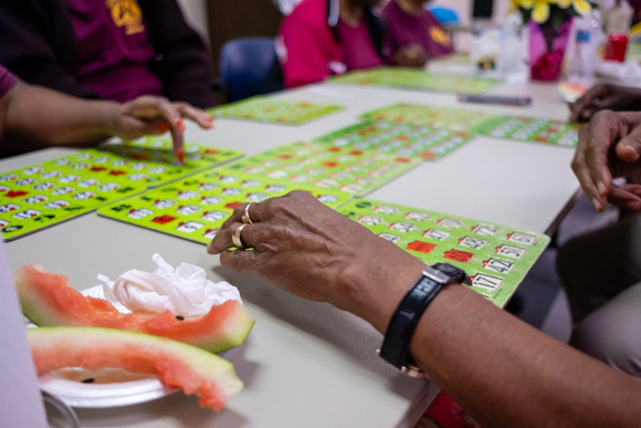 Seniors snack on watermelon and play bingo at the Bickford Community Center. (Brandon Dahlberg)