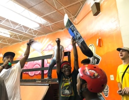 Courtlan Black is all smiles as David Yancey announces him the winner of the boys' aged 13 to 15 division at a skate competition held at the Greenlaw Community Center (Cole Bradley)