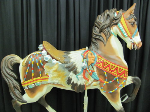 A restored horse as part of the grand carousel.