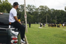 Zan 'Z' Dogan watches his son play in a football game at Treadwell Middle School. Treadwell is the area's oldest school and opened in 1915. (Ziggy Mack)