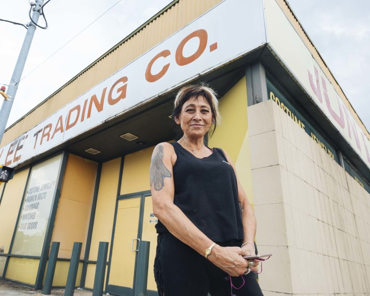 Heights resident Deborah Nahinu stands in front of Jun Lee Trading Co., a staple at Summer and National for more than 30 years. (Ziggy Mac)