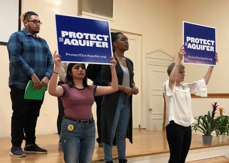 In a scene from the performance, cast members give an artistic re-enactment of neighbors joining together to oppose a proposed neighborhood landfill. From left to right: Michel Angel, Jazmin Bautista, Kierra Turner and Casey Greer. (Scarlet Ponder)