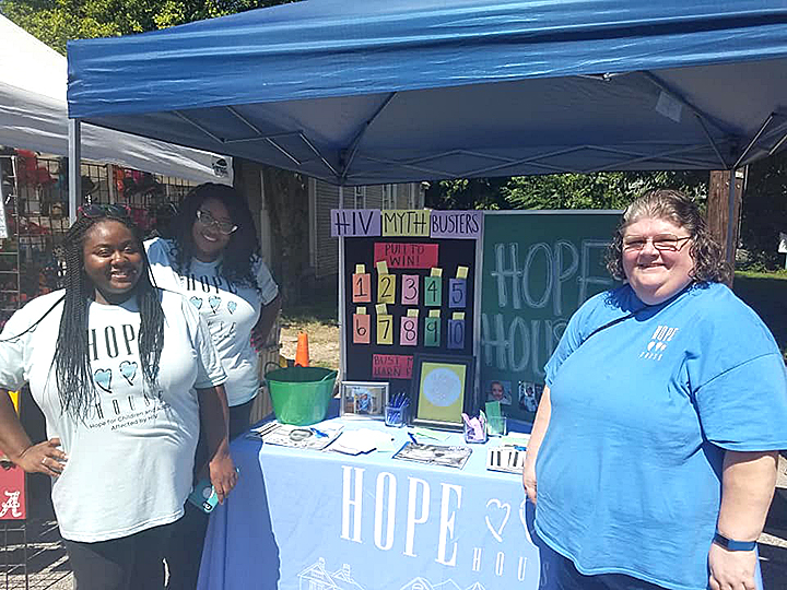 Jessica Cox, far left, works at an outreach booth for HIV awareness in the South City neighborhood in ZIP 38126. (Submitted)