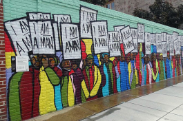 "The ""I'm a Man"" mural was designed by rap artist Marcellous Lovelace in a modern graffiti style and installed by BLK75. It can be found on S. Main Street, close to the National Civil Rights Museum. It shows the Sanitation Workers Protest March on Mar"