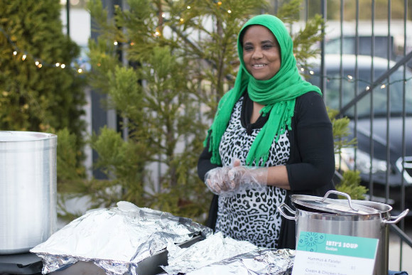 Ibtisam Salih sells Sudanese fare at the Caritas on Broad pop-up shop at the 10th annual Broad Avenue Art Walk.