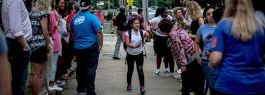 Students at Kingsbury Middle School are greeted on the first day of school by community members showing support after weeks of ICE raids on the Latino community.