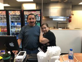 Juan Antonio Hernandez, owner of El Nuevo Mercadito, poses with his wife, Norma Mendoza, at the restaurant's counter. El Nuevo Mercadito is a Mexican restaurant located inside the El Mercadito de Memphis in Hickory Hill. (A.J. Dugger)