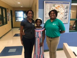 (L to R) Hickory Hill Community Center's assistant director, Danae Lawrence, her daughter and center volunteer, Mya Brady, and center director, Adrianna Moore pose in the center's lobby. (A.J. Dugger III)