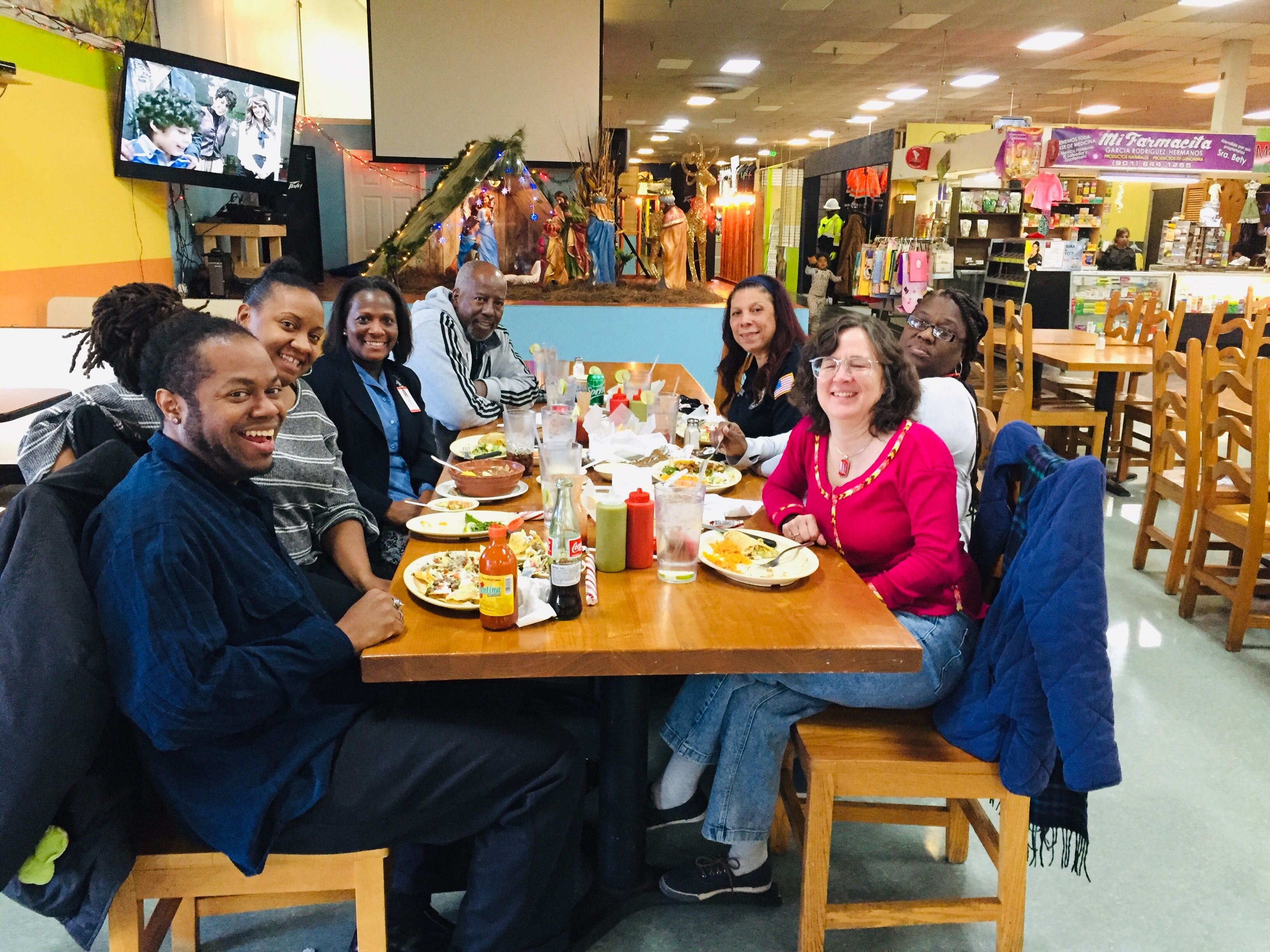 "The High Ground team enjoys a 'thank you' lunch at El Mercadito de Memphis with key stakeholders in our ""On the Ground: Hickory Hill"" coverage, including residents and representatives from nonprofits and the Memphis Police Department. (High Ground)"