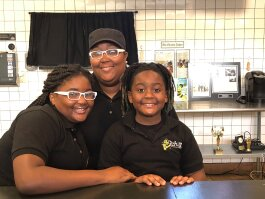 L to R: Kinyah Bean, Valerie Braddock and Demetrius Braddock Jr. Bean is the owner of B Chill Lemonade, located inside the former Hickory Ridge Mall. (A.J. Dugger III)