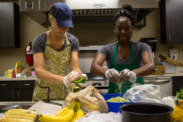 Kristin fox-Trautman and Charlena Branch working with food at Kaleidocope Kitchen in Binghampton.