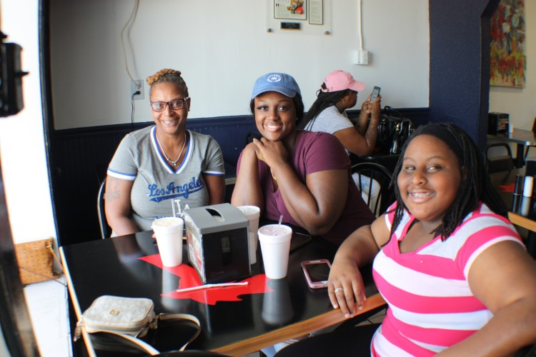 Felecia Rucker (L) brought her daughters to Riko's to try the food and says it's their new go-to spot for chicken. (Cole Bradley)