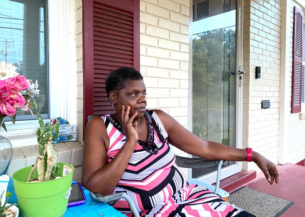 Geraldine Williams, 63, sits on her porch in North Memphis. Williams is a bus driver Durham School Services who says she'll be back in the driver's seat as soon as she can. (Shelia Williams)