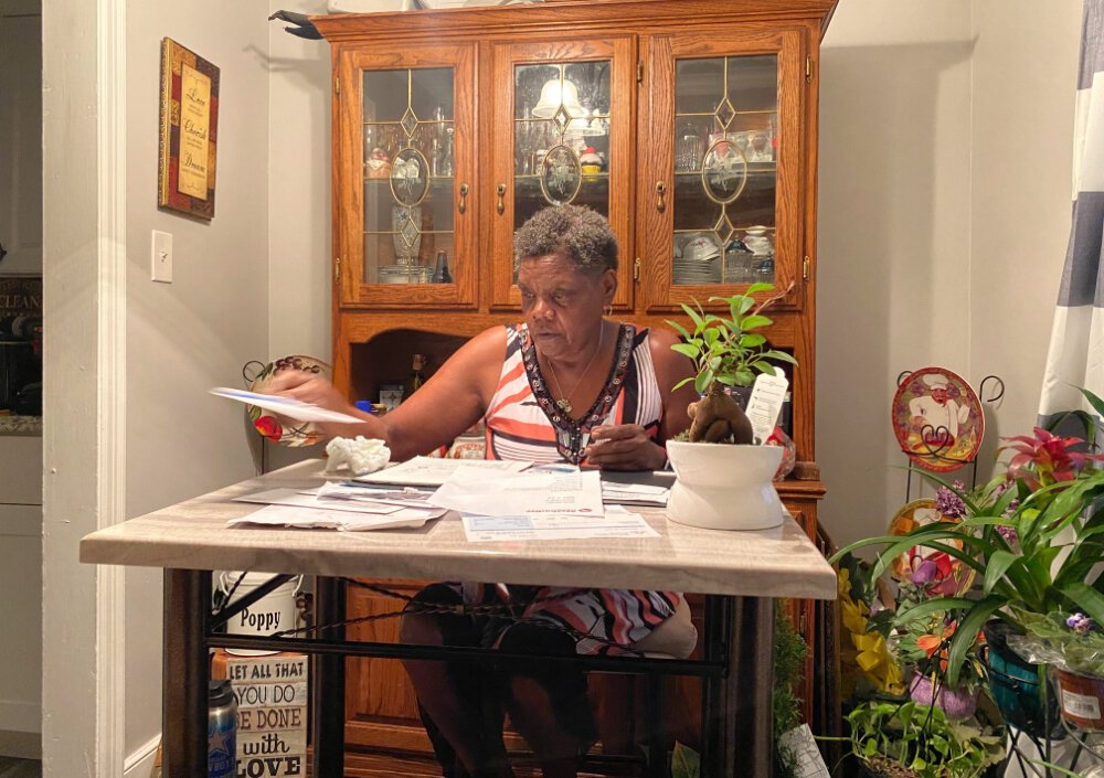 Geraldine Williams sorts through bills at her dining room table. A bus driver for the last 13 years, Williams has been on unemployment since Shelby County Schools closed in March. She receives approximately $247 a week. (Shelia Williams)