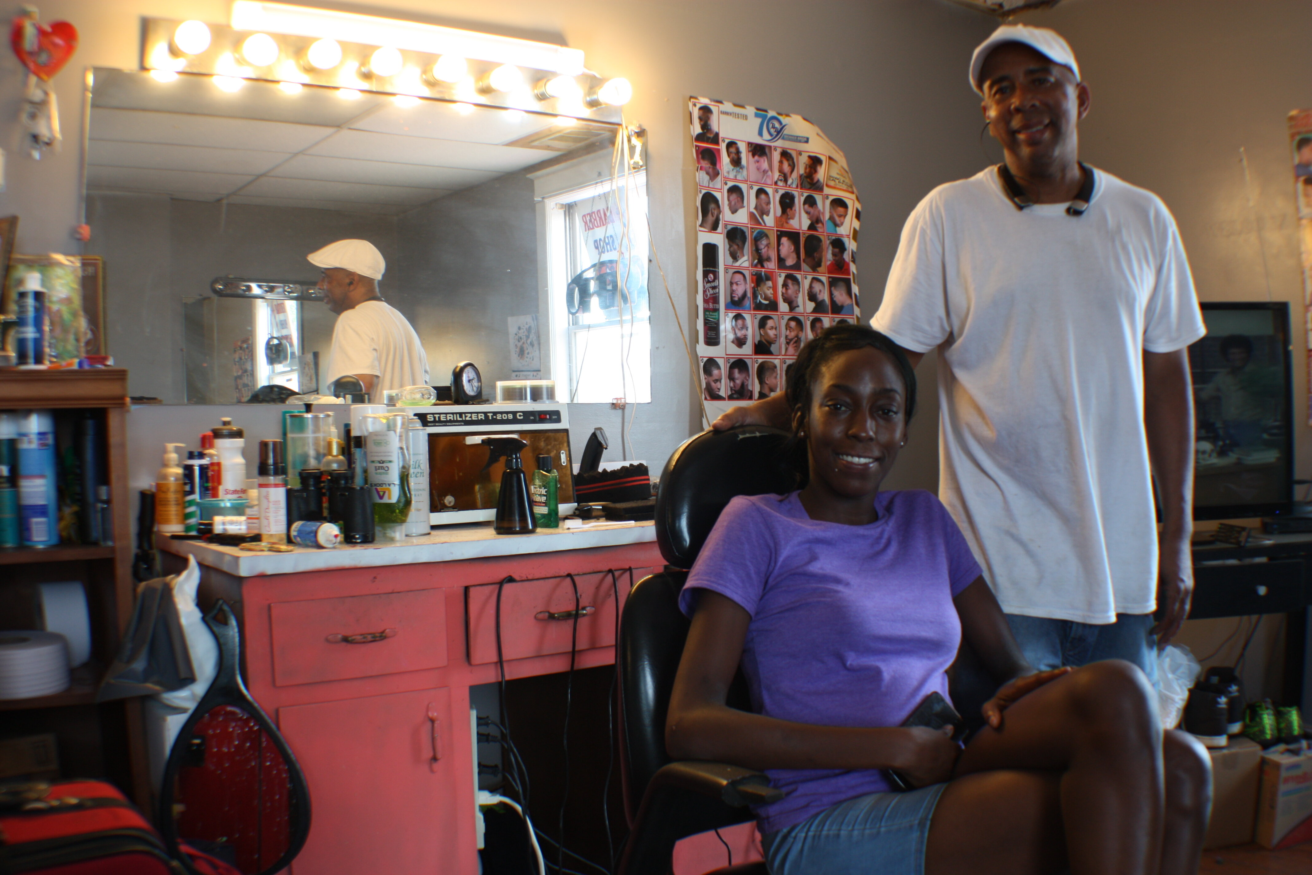 Stylist Erica Ward and master barber and manager Tony Mckissick pose inside Pyramid Famous Cutz. (Cole Bradley)