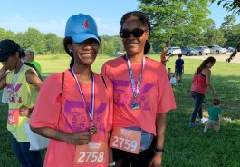 Stephanie Parker-Bradley and her daughter, Faith Bradley, celebrate after completing The Hagar Center 5K Fun Run. (Ashlei Williams)