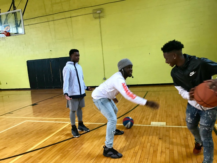 Teens and staffers play basketball during downtime between programs like financial literacy classes and service projects. (Cole Bradley)