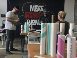 Members of the Creatives in Research team assemble tubing that will become 35 umbrella stands strategically placed throughout Madison Heights. (Wonder / Cowork / Create)