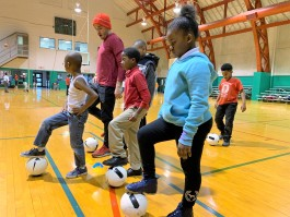 Joel Katz, senior manager, Youth Sports Partnership with the Memphis Grizzlies Foundation, leads a group of Play Where You Stay students in soccer drills at the Gaston Community Center. (Submitted)