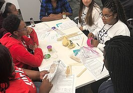 Attendees from the 2017 InventHER STEM Conference engage in a workshop. (InventHer)